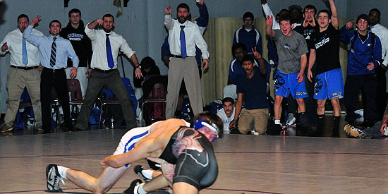 Lindsey Wilson sideline reacts to a takedown during tonight's win over Campbellsville